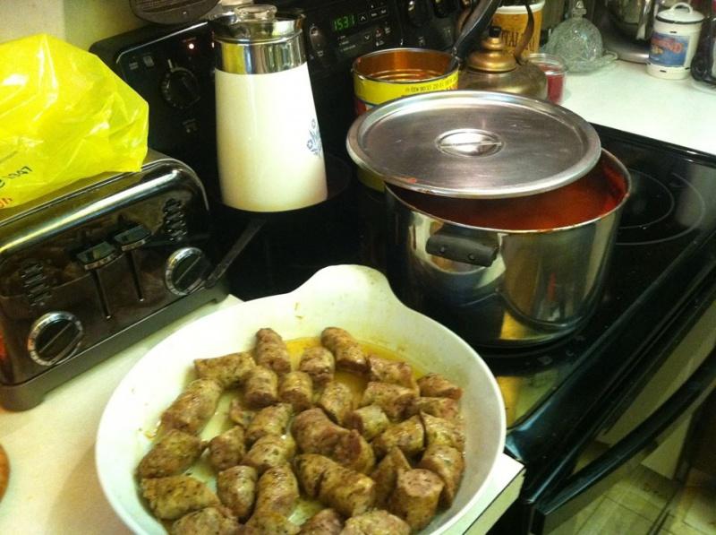 Sausage and a big pot of sauce.